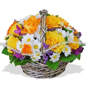 Spring greetings - basket of roses, chrysanthemums and statice